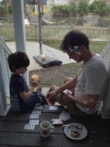 Aidan and Harlan play blackjack in our Cambridge backyard during lockdown